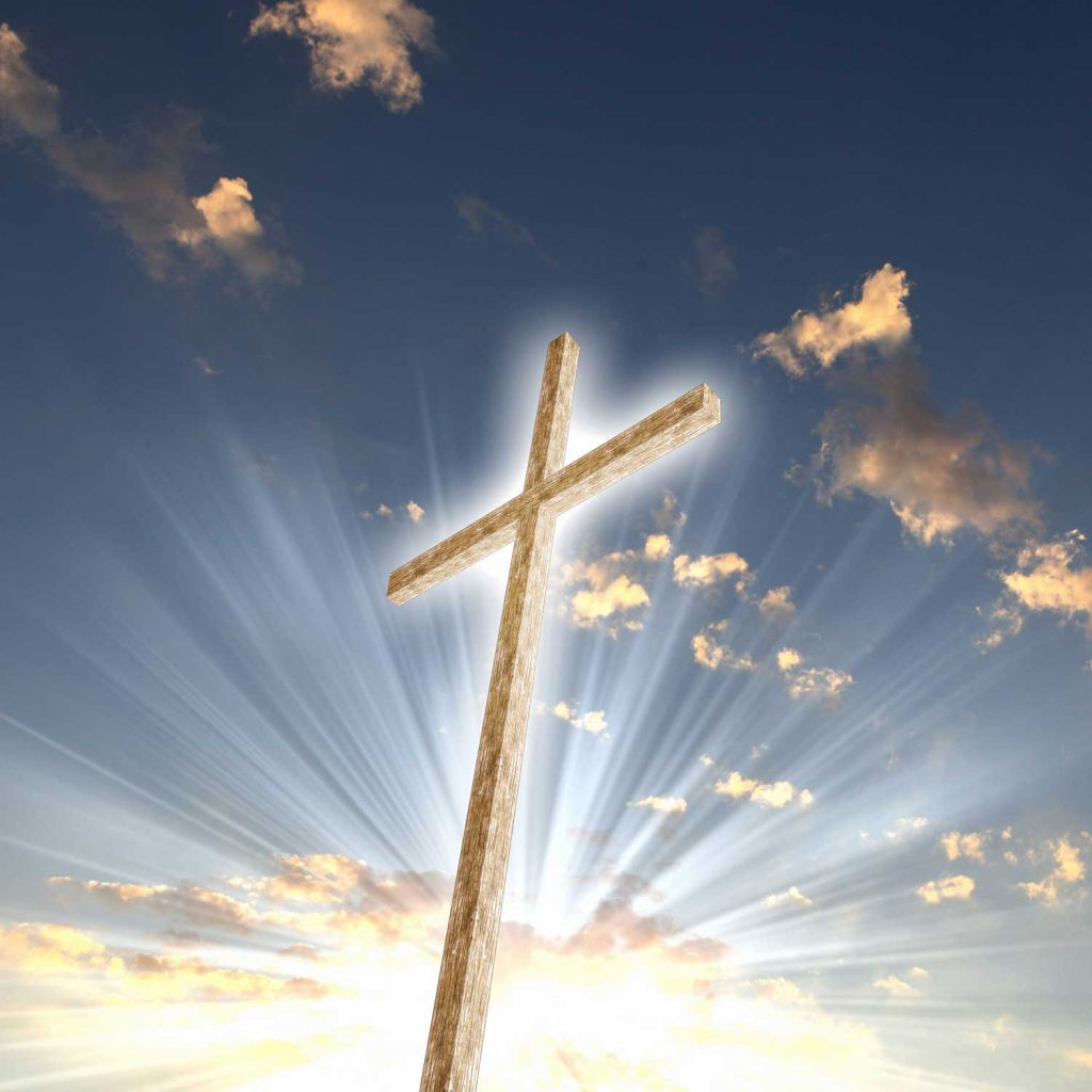 Glowing cross in the clouds