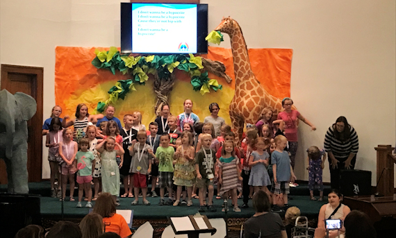 CHildren performing at VBS in CHurch