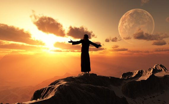 worship2Jesus with his arms out on a cliff